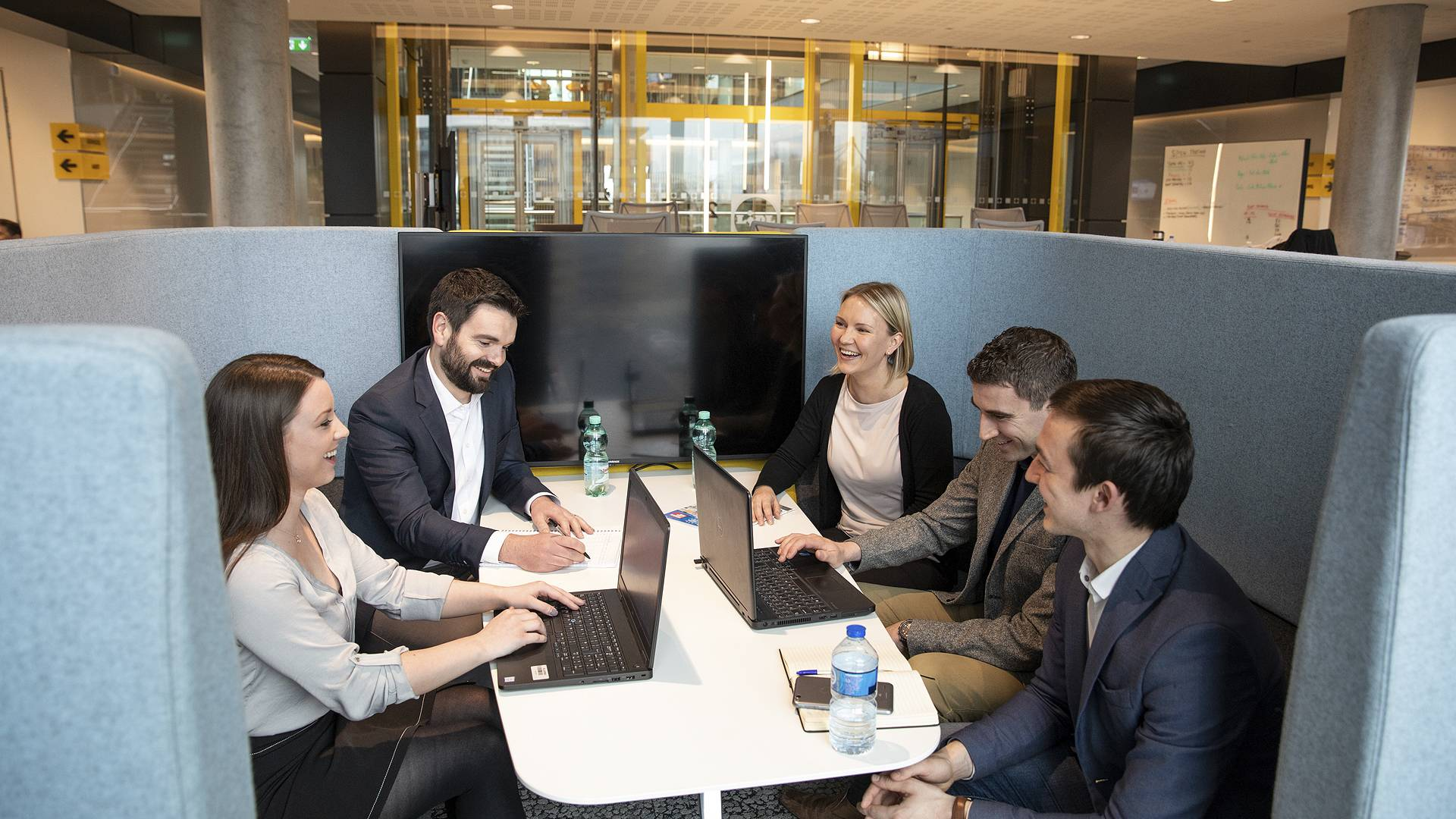 Office - Group of people in huddle space